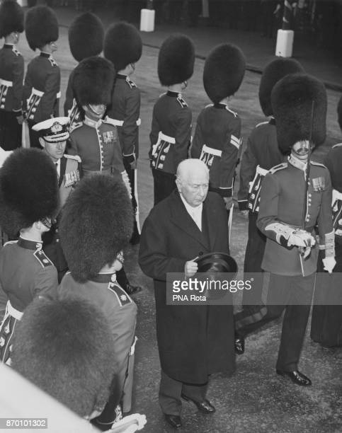 West German President Theodor Heuss inspects a Guard of Honour of the 2nd Battalion Scots Guards upon his arrival at Victoria Station in London from...
