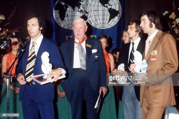 West Germany captain Franz Beckenbauer makes a speech after the presentations at the victory banquet held at the Hilton Hotel in Munich watched by...