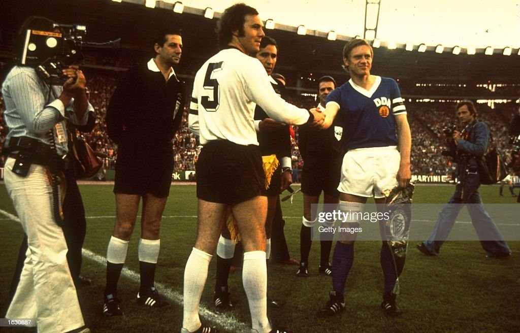 West Germany Captain <a gi-track='captionPersonalityLinkClicked' href=/galleries/search?phrase=Franz+Beckenbauer&family=editorial&specificpeople=210545 ng-click='$event.stopPropagation()'>Franz Beckenbauer</a> #5 shakes hands with the East Germany Captain before a match. \ Mandatory Credit: Allsport UK /Allsport
