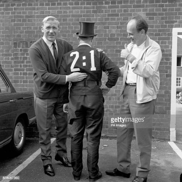 A West Germany fan dressed as a chimney sweep is congratulated on his prediction for the World Cup Final scoreline by team advisor Bert Trautmann and...