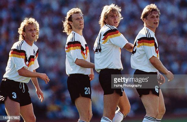 West Germany players Andreas Brehme Wolfgang Rolff Jurgen Klinsmann and Ulrich Borowka line up to defend a free kick during the UEFA European...