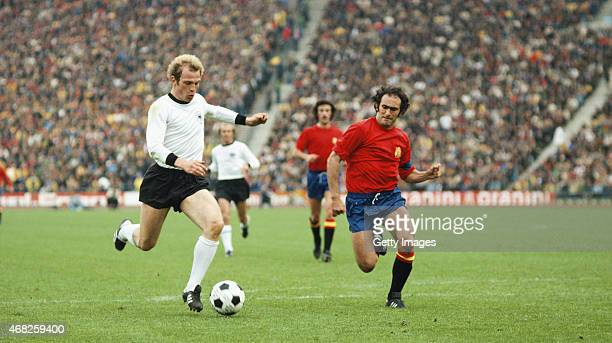 West Germany striker Uli Hoeness outpaces Jose Martinez Pirri of Spain during the 1976 UEFA European Championships Quarter Final between West Germany...