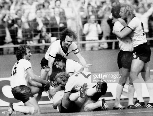 West Germany's Gerd Muller is mobbed by teammates after scoring the second goal Rainer Bonhof Franz Beckenbauer Heinz Flohe and Berti Vogts Wolfgang...