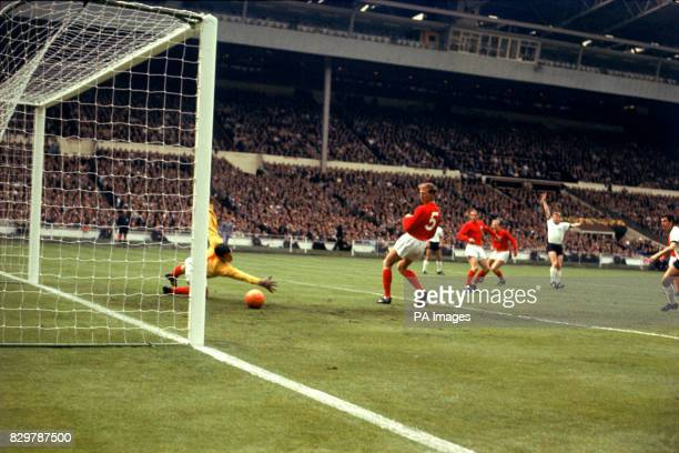 West Germany's Helmut Haller begins to celebrate as his shot beats England goalkeeper Gordon Banks for the opening goal watched by England's Jack...