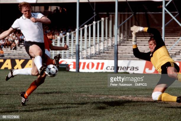 West Germany's Horst Hrubesch volleys a shot goalwards as Holland goalkeeper Piet Schrijvers dives