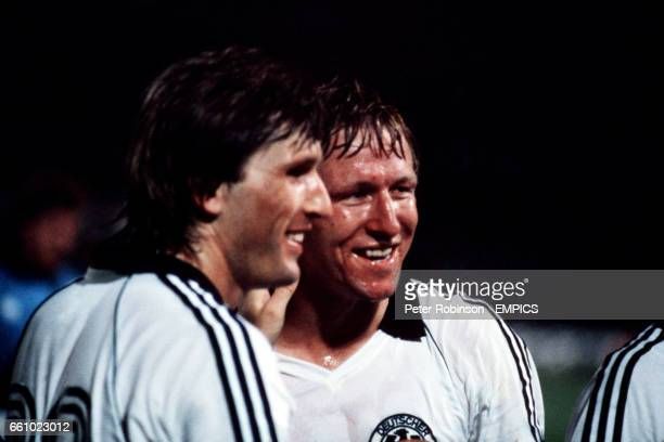 West Germany's Manny Kaltz and Horst Hrubesch celebrate victory