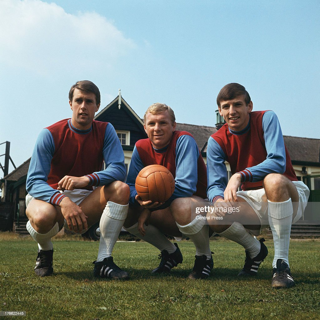 West Ham and England footballers (left to right), <a gi-track='captionPersonalityLinkClicked' href=/galleries/search?phrase=Geoff+Hurst&family=editorial&specificpeople=206880 ng-click='$event.stopPropagation()'>Geoff Hurst</a>, <a gi-track='captionPersonalityLinkClicked' href=/galleries/search?phrase=Bobby+Moore&family=editorial&specificpeople=206646 ng-click='$event.stopPropagation()'>Bobby Moore</a> (1941 - 1993) and Martin Peters, 1966. All three are members of the1966 World Cup-winning England team.