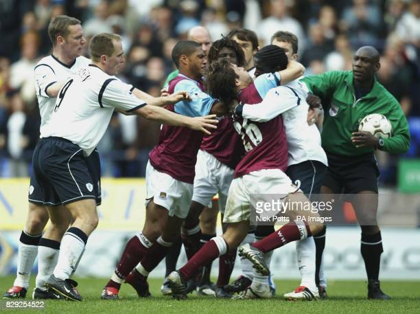 West Ham captain Joe Cole and Bolton's French defender Bernard Mendy at the end of the crucial Premiership relegation decider 20/04/03 Greater...
