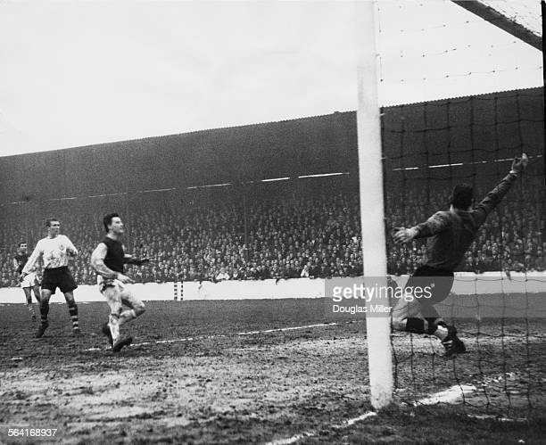 West Ham centre forward Johnny Byrne scores past Burnley goalkeeper Adam Blacklaw in an FA Cup Sixth Round match at Upton Park stadium London 29th...