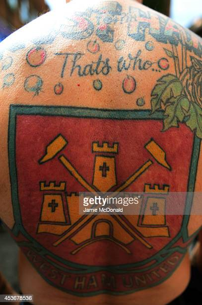West Ham fan displays his tattoos prior to kickoff during the Barclays Premier League match between West Ham United and Tottenham Hotspur at Boleyn...