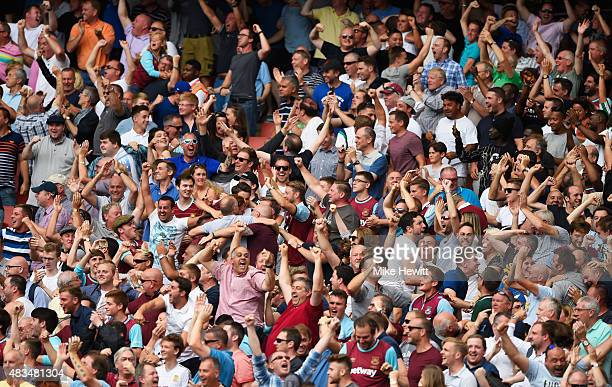 West Ham fans celebrate after Cheikhou Kouyate of West Ham United scored the opening goal during the Barclays Premier League match between Arsenal...