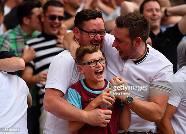 West Ham fans celebrate victory after the Barclays Premier League match between Arsenal and West Ham United at the Emirates Stadium on August 9 2015...