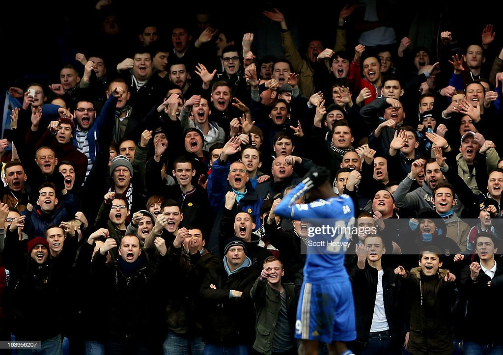 West Ham fans mock Chelsea's Demba Ba during the Barclays Premier League match between Chelsea and West Ham United at Stamford Bridge on March 17, 2013 in London, England.