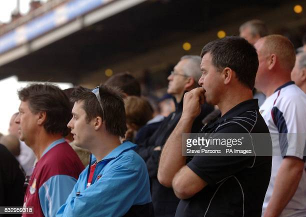 West Ham fans watch a nail biting game from the stands