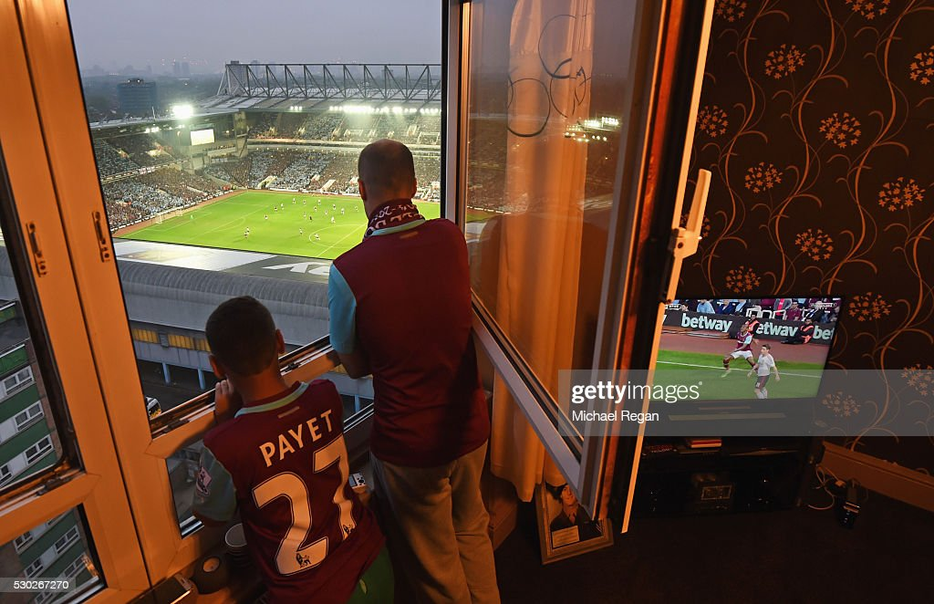West Ham fans watch the action from a nearby block of flats during the Barclays Premier League match between West Ham United and Manchester United at the Boleyn Ground on May 10, 2016 in London, England. West Ham United are playing their last ever home match at the Boleyn Ground after their 112 year stay at the stadium. The Hammers will move to the Olympic Stadium for the 2016-17 season.
