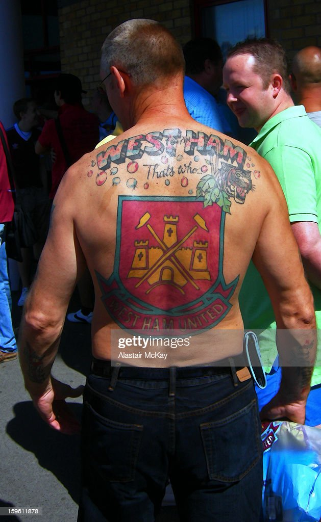 West Ham football fan shows his support outside the club;s stadium, the Boleyn Ground (aka Upton Park), London.