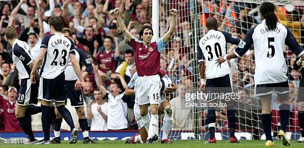 West Ham goal scorer Yossi Benayoun celebrates surrounded by Tottenham players during their Premiership football match against Tottenham at home to...