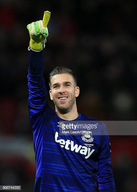 West Ham goalkeeper Adrian celebrates the draw following the Barclays Premier League match between Manchester United and West Ham United at Old...