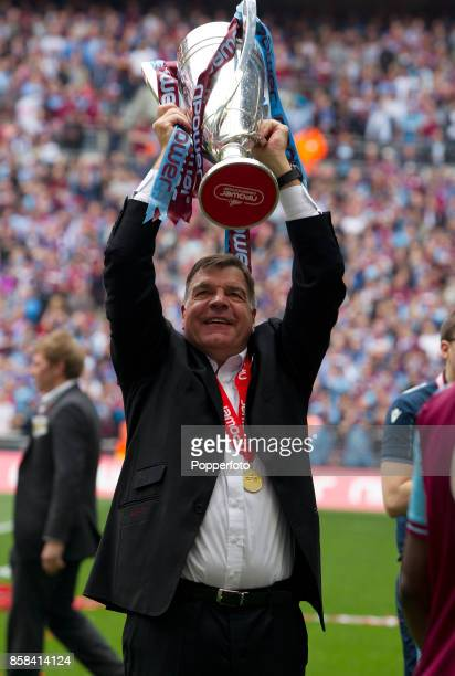 West Ham manager Sam Allardyce celebrates with the trophy after his team win the nPower Championship Playoff Final between West Ham United and...