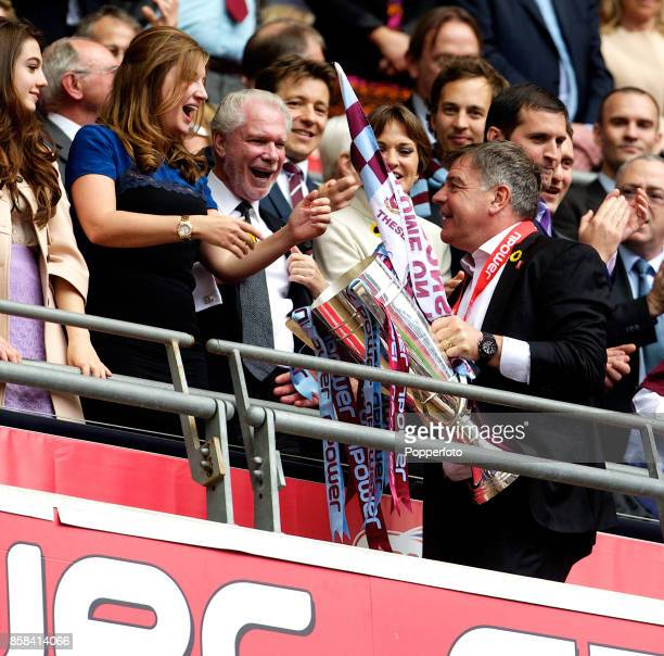 West Ham manager Sam Allardyce celebrates with ViceChairman of the club Karren Brady and Joint Chairman David Gold after winning the nPower...