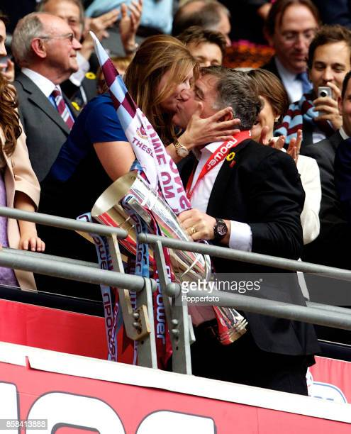 West Ham manager Sam Allardyce gets a kiss from ViceChairman of the club Karren Brady at the end of the nPower Championship Playoff Final between...
