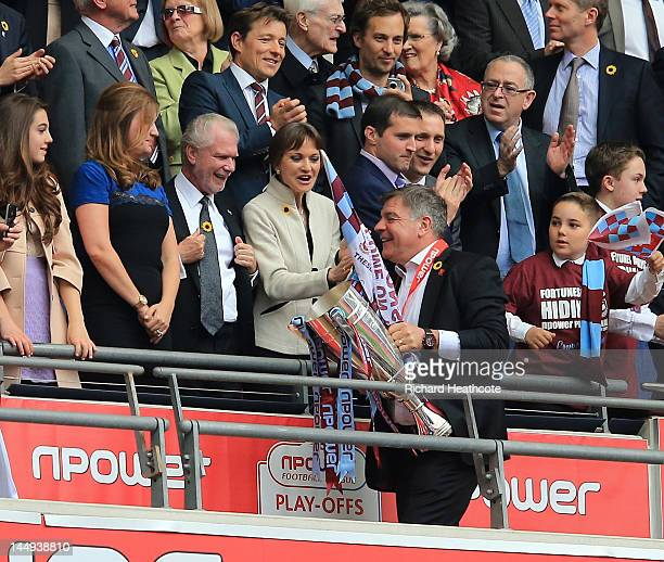 West Ham manager Sam Allardyce is congratulated by vicechairman Karren Brady and Chairman David Gold after victory in the npower Championship Playoff...