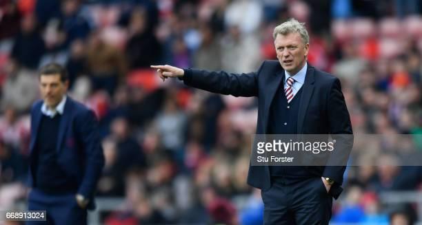 West Ham manager Slaven Bilic and David Moyes of Sunderland react during the Premier League match between Sunderland and West Ham United at Stadium...