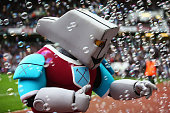 West Ham mascot Hammerhead talks to fans prior to the Barclays Premier League match between West Ham United and Manchester City at Boleyn Ground on...