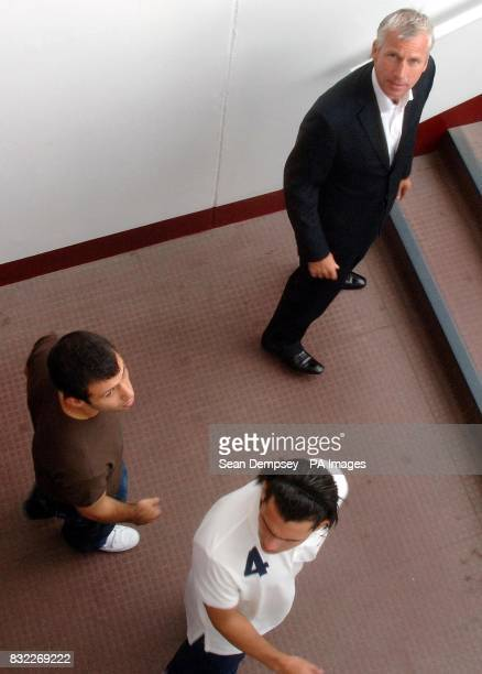 West Ham new signings Carlos Tevez and Javier Mascherano with manager Alan Pardew following a press conference at Upton Park East London
