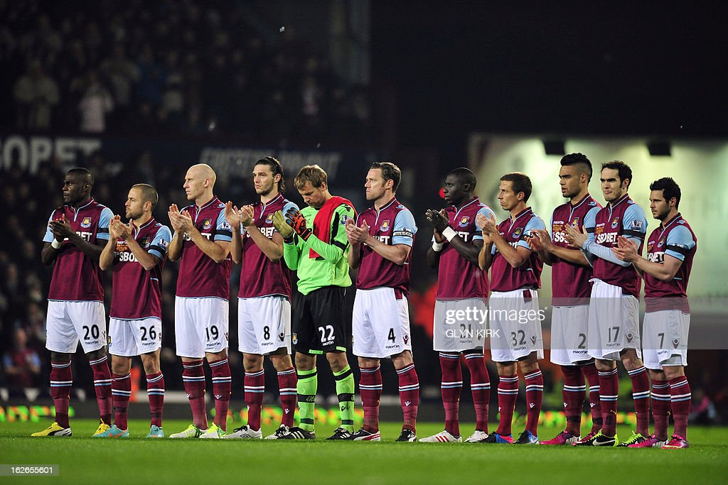 """West Ham players applaud during a 'minutes applause' in tribute to the memory of West Ham and England legend Bobby Moore, before the start of the the game against Tottenham in an English Premier League football match at the Boleyn Ground, Upton Park, in east London, on February 25, 2013. USE. No use with unauthorized audio, video, data, fixture lists, club/league logos or """"live"""" services. Online in-match use limited to 45 images, no video emulation. No use in betting, games or single club/league/player publications."""