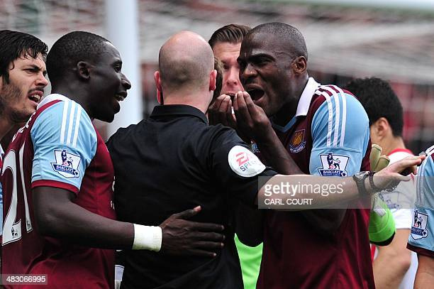 West Ham players English defender James Tomkins Senegalese midfielder Mohamed Diame Spanish goalkeeper Adrian and Ivorian defender Guy Demel surround...