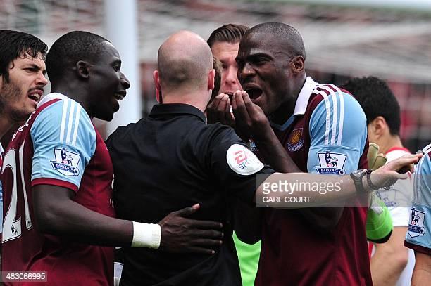 West Ham players English defender James Tomkins Senegalese midfielder Mohamed Diame Spanish goalkeeper Adrian and Ivorian defender Guy Demel surround...