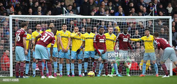 West Ham players line up alongside the Crystal Palace defensive wall during the Barclays Premier League match between West Ham United and Crystal...