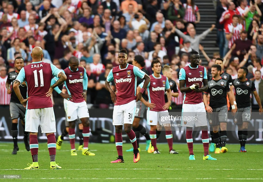 West Ham players look dejected as James Ward-Prowse of Southampton scores their third goal during the Premier League match between West Ham United and Southampton at London Stadium on September 25, 2016 in London, England.