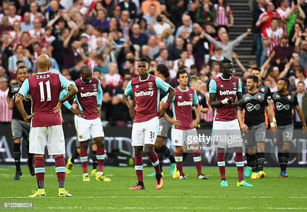West Ham players look dejected as James WardProwse of Southampton scores their third goal during the Premier League match between West Ham United and...