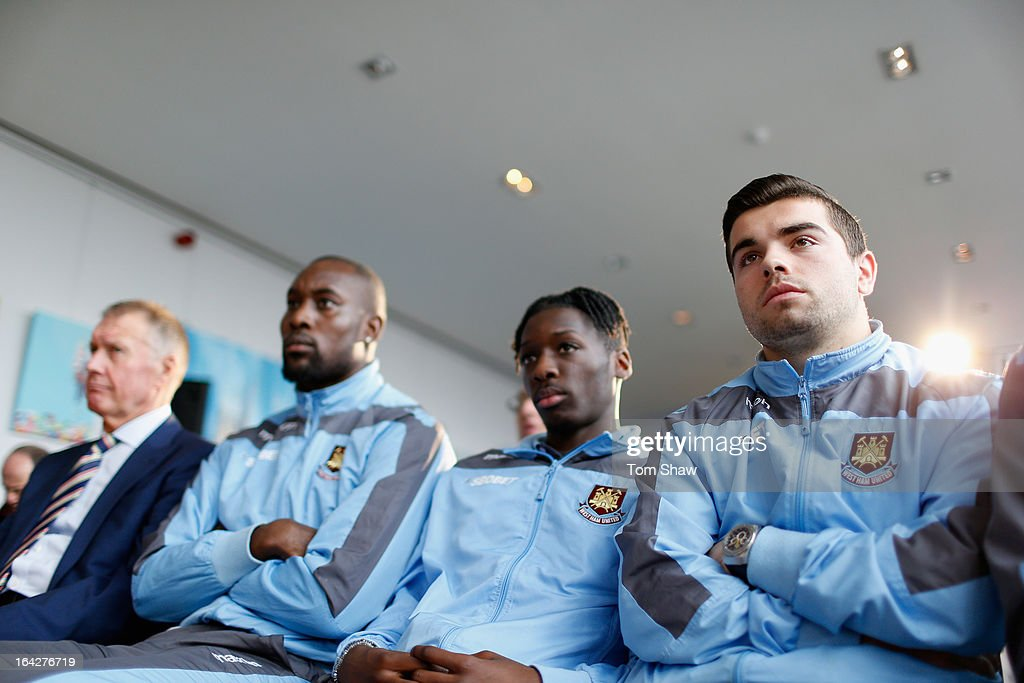 West Ham players look on during the press conference during the press conference to announce the future of the Olympic Stadium on March 22, 2013 in London, England. West Ham United have been announced as the main tenants of the Olympic Stadium, paying 15 million GBP upfront towards conversion costs and an annual rent of 2 million GBP. West Ham will play their home matches at the Stadium from 2016.
