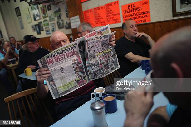 West Ham supporter reads a newspaper in a cafe near West Ham United FC's Boleyn Ground on May 10 2016 in London England Tonights Premier League match...