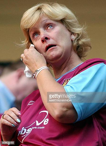 West Ham supporter wipes after her side was beaten by Crystal Palace in the Nationwide Division One play off at Cardiff's Millennium Stadium 29 May...