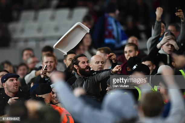 West Ham United and Chelsea fans clash during the EFL Cup fourth round match between West Ham United and Chelsea at The London Stadium on October 26...