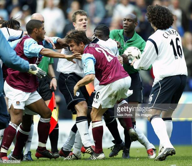 West Ham United captain Joe Cole fights with Bolton Wanderers Bernard Mendy at final whistle during the Barclaycard Premiership match at the Reebok...