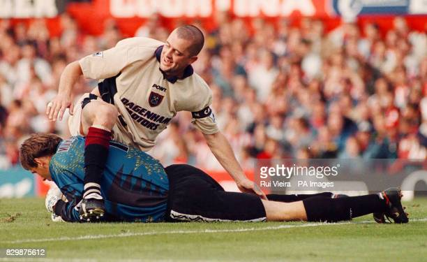 West Ham United captain Julian Dicks gets entangled with his own goalkeeper Ludek Miklosko after a successful save during their FA Carling...