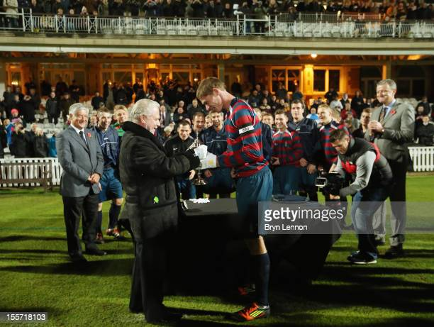 West Ham United Chairman David Gold presents the first ever FA Cup to Royal Engineers AFC Captain Jay Hubbard after winning the First FA Cup Final...