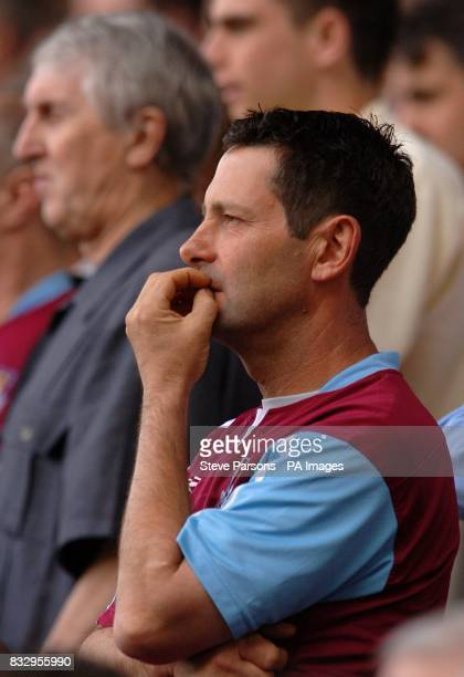 A West Ham United fan bites his nails during the game