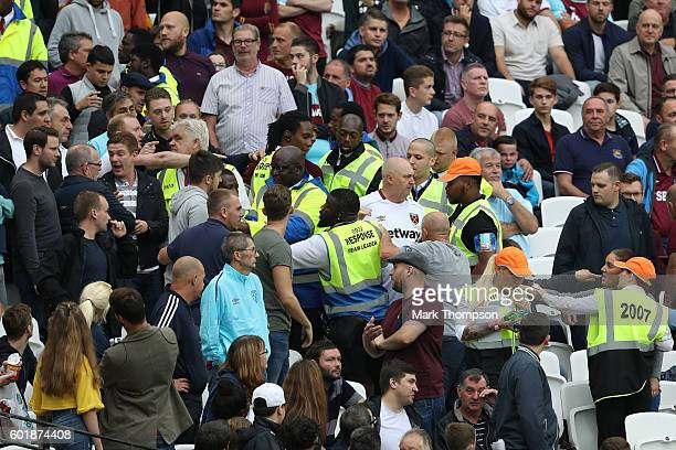 West Ham United fans and Watford fans clash during the Premier League match between West Ham United and Watford at Olympic Stadium on September 10...