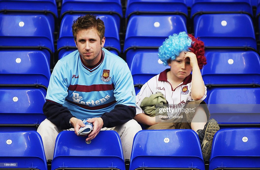 West Ham United fans look dejected after their team are relegated after the FA Barclaycard Premiership match between Birmingham City and West Ham...