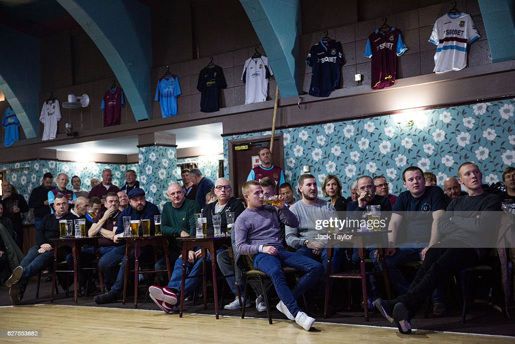 West Ham United Football Club fans attend a pre-match event at the East Ham Working Men's Club in Upton Park on December 3, 2016 in London, England. West Ham United played Arsenal in a Premier League match on December 3, which marks more than six months since the football club moved from their Boleyn Ground stadium in Upton Park to the London Stadium in Stratford. Local businesses are suffering as the former West Ham United ground is being demolished to make way for more than 800 homes.