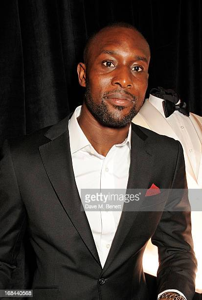 West Ham United football player Carlton Cole attend 'A Night of Sporting Gold' hosted by bespoke tailor Apsley at their Pall Mall showroom on May 9...