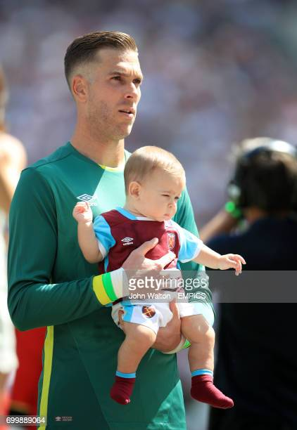 West Ham United goalkeeper Adrian and child