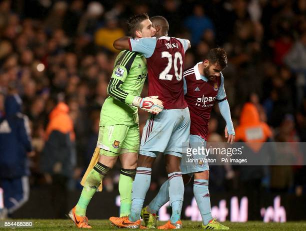 West Ham United goalkeeper Adrian is embraced by teammate Guy Demel after making a good save