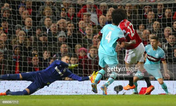 West Ham United goalkeeper Adrian saves a shot from Manchester United's Marouane Fellaini